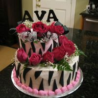 "Baby Ava's Cake Zebra Stripes with pink accents and pink roses. 6""-10"" round stacked offset. Icing is buttercream. Zebra stripes are fondant. 2&..."