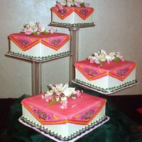 Square Hmong - Inspired Wedding Cake the rich bright colors represent the bright colors of Hmong clothing...gumpaste flowers on top of cakes...airbrushed the cake...
