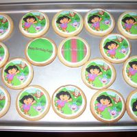 Dora Cookies   These went with the Dora cake. They have an edible image of Dora on them.