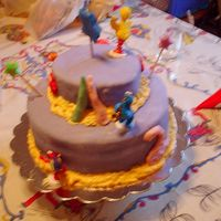 My Cousin's Birthday (Side 2) This cake was made for my cousin's second birthday. The crayons and the number 2 were made with candy clay elmo was made out of...