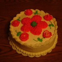 Wilton Cake Course I This is a yellow cake filled with buttercream icing. I piped buttercream roses & used piping gel to outline the large flower in the...