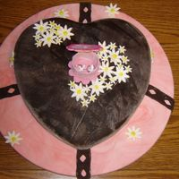 Anthony's Shower This is a vanilla cake covered in chocolate fondant for a co-worker who is getting married. The board (drum) was rolled in marblized pink...