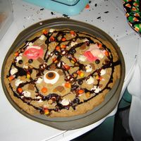 Halloween Pizza Cookie This is a homemade cookie made in a pizza pan topped with marshmellows, chocolate chips, candy corn, caramel and, of course, chocolate...