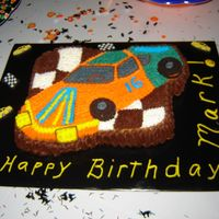 "Happy Birthday Mark This is a butter cake iced in all buttercream for my nephew Mark's ""Sweet Sixteen"" birthday party. The tires are Oreo..."
