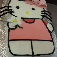 Hello Kitty Believe it or not this was made for a 24 year old who loves Hello Kitty. Base of BC with fondant pieces.