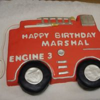 Firetruck Truck was make of fondant and tires were rice krispies.