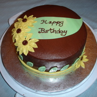 Yellow Daisy Birthday Cake Chocolate buttercream with fondant accents.