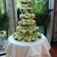 Cupcake Wedding Tower Cupcakes wedding - BC icing on vanilla and chocolate cupcakes - bumble bees and daisies made of gumpaste. Bride was a garden lover - thus...