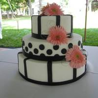 Black And White   White fondant iced with black fondant details, silver wire curly cues and peach florals...