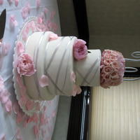 Pink And Pewter   White fondant iced, pewter ribbon with pink florals.