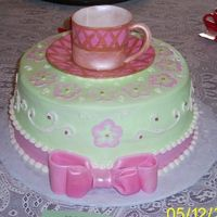Mothers Day Tea This cake is a 5 layer yellow with half lemon & half chocolate buttercream filling The cake is iced with buttercream. The ribbon is...
