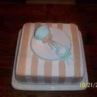 Baby Shower Cake Cake is covered in fondant. Rattle is cake balls molded and covered in fondant. Found inspiration here!