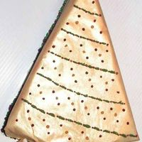 Golden Christmas Tree White chocolate raspberry cheesecake on chocolate crust. Wrapped in pure white chocolate with old gold luster dust, bc decorations.