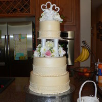 Champagne Wedding Cake.. I made this cake for my sister in-laws wedding.. White cake with lemon filling covered in buttercream.. It was GOOOOD..