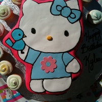 Hello Kitty.. Made this one for a cute little girl... Made fondant birds and flowers to go on sides.. Also made cupcakes with colored sugar on top..