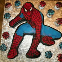 Spider Man.. This was a challenge.. But I think it turned out great!! A lot of hand piping and airbrushing ... also the cupcakes had webs too..