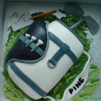 Golf Bag Sponge cake, covered in fondant icing with buttercream grass.