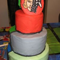 Star Wars This is the other side of the Power Ranger cake for my nephews. Again its a 3 tiered chocolate cake with buttercream icing. Black fondant...