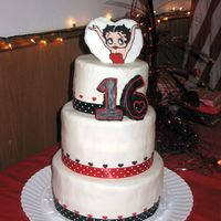 Betty Boop Sweet 16 I made this for my cousin. It is a 3 tiered white cake with strawberry cream cheese filling. Buttercream icing. The ribbon is real ribbon...