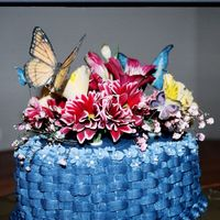 Mothers Day Cake Made of buttercream basketweave real flowers and edible butterflies on floral wire