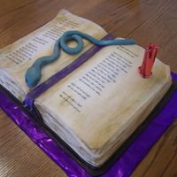 Witch's Spellbook  Thank you to Brokestar for letting me attempt to copy her wonderful idea! This is the 1/2 sheet size Wilton book pan. The cake is Vanilla...