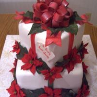 Gift Cake WASC covered in fondant with gumpaste bow and fondant ribbons. Flowers are silk.