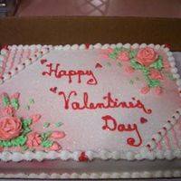 Vday2.jpg White cake with all buttercream decorations . The corners were lightly airbrushed with red and the red hearts were done with candy melts.