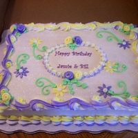 Daisy Birthday Cake   White almond sour cream 1/2 sheet cake with buttercream icing and fondant decorations.