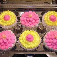Flower Cupcakes I made these for someone's last day at work. They are WASC cupcakes with raspberry BC filling and lemon BC. I was just trying out some...