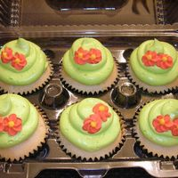 Chartreuse Cupcakes I made these cupcakes for a co-worker's birthday. Chartreuse/bright green is her favorite color. They are WASC cupcakes iced in IMBC...