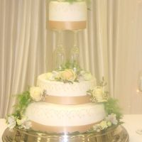 Wedding Cake Held Up By Champagne Flutes