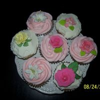 Cup Cakes! First try at decorated cupcakes. Wow, much easier than decorating a cake! 100% butter BC icing, gumpaste and royal flowers and leaves. I...