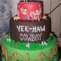 Woody Cowboy Cake 3-double layers- bottom layer green, middle layer chocolate and top layer yellow all buttercream,. the figures were provided by the gramma...