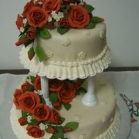 Tiered Cake final cake at wilton course 3, fondant mixed with gumpaste roses!