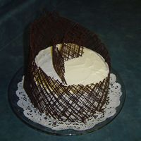 Chocolate Lattice   chocolate lattice band, whipped cream frosting on a chocolate cake