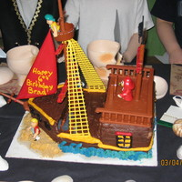 Pirate Ship This was the 2nd attempt. It was for a boys birthday. Besides the toppers, the ship was decorated using buttercream icing.