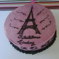 Eiffel Tower Theme Pink in Paris was the theme of this shower. I free-handed the eiffel tower and used pattern stamps to draw the designs.