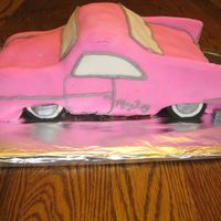 "Mary Kay Pink Cadillac I used a 3 layer 10"" cake and carved out the car design, then decorated in MMF. In order to make it silver, I used a damp brush with..."