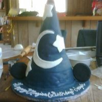 "Mickey Sorcerers Hat I used a couple layers of a 6"" round and an 8"" round then used a styrofoam piece for the top. I decorated in fondant and..."