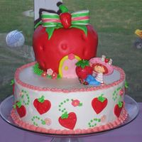 "Strawberry Shortcake My daughters 4th birthday cake! The strawberry is made of rice krispy treats covered in mmf. 10"" cake is buttercream with fondant..."