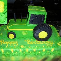 John Deere Front wheels made from oreo's covered in icing. Back wheels 3' cakes. Pipes a straw and candy stick covered in icing. The corn is...