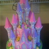 Castle For a 1st birthday princess. Made from the wilton castle kit.