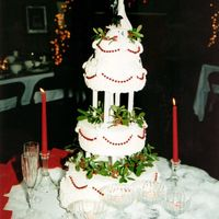 A Christmas Wedding  This is a traditional vanilla flavored buttercreme cake. The beads are real christmas tree decrations. I got married on Christmas day and I...
