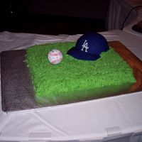 Wayne's Baseball Groom's Cake Peppermint cake with piped grass, fondant cap, and real baseball signed by friends.