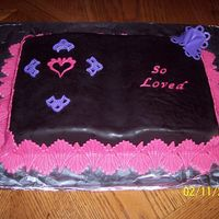 "Valentine's Day Cake For Church 2007--""so Loved""  Book cake (tangerine) covered with chocolate MMF with pina colada MMF accents. It had lots of flaws because I was just making it to..."