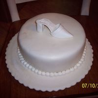 "Jaime's Bridal Shower--Bridal Shoe Cake  10"" round covered with buttercream and fondant, lightly dusted with pearl dust. The shoe was made using the pattern linked to the..."