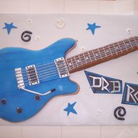 Paul Reed Smith Guitar  To scale PRS guitar. Covered in fondant with GP decorations. I made for my friends birthday. Special thanks to 1 nanette and minie for the...