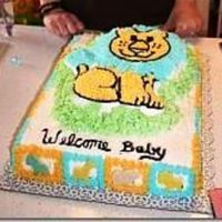 Jennifer's Jungle Baby Shower Lion Cake This baby shower was a jungle theme. The lion on top was a white cake. The sheet cake was chocolate with a filling I made from a Cream...
