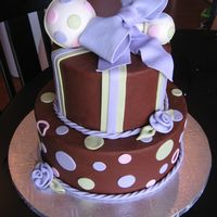 Green And Purple Baby Shower   Chocolate Buttercream with fondant accents. The rattle is styrofoam covered with fondant. Inspired by Sugarshack!
