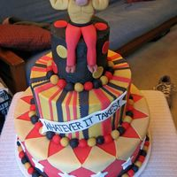 Spirit Week   This cake was made for a middle school's spirit week. The bull mascot was sculpted from fondant.